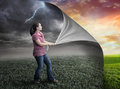 Storm and sunset woman pulls pack page reveals Royalty Free Stock Photo
