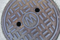 Storm water drain cover. Royalty Free Stock Photo