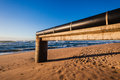 Storm water pipe on concrete structure for dispersion flooding rain water onto the beach Stock Image