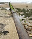 Stormwater pipe on sandy beach Stock Photos