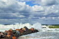 Stormy baltic sea and breakwater beautiful storm in sunny summer s day Royalty Free Stock Photography