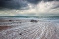 Stormy dark sky over Atlantic ocean beach Royalty Free Stock Photography