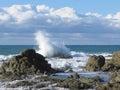Stormy sea and sailboat along Tuscany coastline in Livorno, Italy Royalty Free Stock Photo