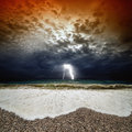 Stormy sea sunset dramatic nature background waves dark sky with lightning Stock Photo
