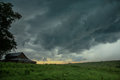 Stormy skies over an old barn in the country Royalty Free Stock Photo