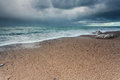 Stormy sky over rock beach in atlantic ocean normandy france Stock Photo