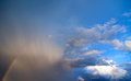 Stormy sky with a rainbow on blue Royalty Free Stock Photography