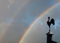 Stormy sky with rainbow, weather vane Royalty Free Stock Photo