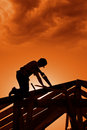 Stormy sunset on construction site Royalty Free Stock Photo