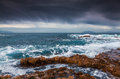 Stormy weather on the volcanic beach on nature reserve Piscina d Royalty Free Stock Photo