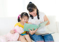 Story time asian mother reading to daughter Royalty Free Stock Photos