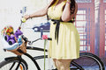 Stout female participant of cycle parade lady on bicycle moscow aug at sokolniki park stands with bike near phone booth august Royalty Free Stock Images