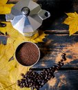 Stove top espresso maker and dark roast coffee for the autumn weather Royalty Free Stock Photo