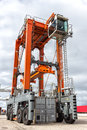 Straddle carrier for moving containers in a shipping port Stock Photography