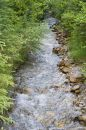 Straight creek in the mountains Stock Photo