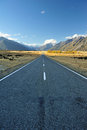 Straight empty highway leading into aoraki mount cook Stock Photo