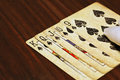 Straight flush on the wooden table