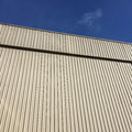 Straight lines of metal sheet siding, Texture background. Royalty Free Stock Photo