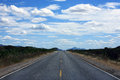 Straight road of ceara state in brazil with blue sky and clouds Stock Images
