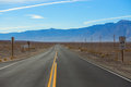 Straight road in desert Royalty Free Stock Photo