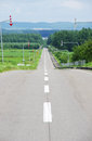 Straight road in japan hokkaido Royalty Free Stock Photos