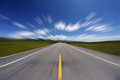 Straight road under blue sky asphalt motion blur Stock Image