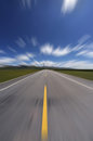 Straight road under blue sky asphalt motion blur Royalty Free Stock Photography