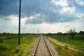 Straight rural railway long with vanishing point Stock Photo