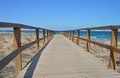 Straight to the mediterranean a wooden walkway going beach and waters edge Royalty Free Stock Photography