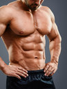Strained chest and abs. Royalty Free Stock Photo