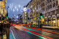 Strand in london at christmas uk th november a view along the night during the season showing the streets and decorations Royalty Free Stock Photos