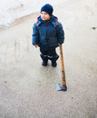 Strange child holding axe Royalty Free Stock Images
