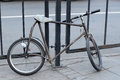Strange handmade custom modding bicycle on moscow street locks to the fence in cloudy day Stock Image
