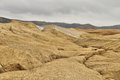 Strange landscape by active mud volcanoes muddy river from buzau romania Stock Photography