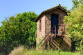Strange little building somewhere in a rural area with highly oxidized iron staircase it is completely unclear who is the owner Stock Photography