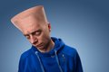 Strange man with big head a flat over blue Stock Images
