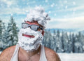 Strange man with shaving foam on his face smiling in glasses over winter background Royalty Free Stock Image
