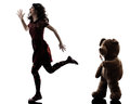 Strange young woman and killer teddy bear silhouette one caucasian in white background Royalty Free Stock Images