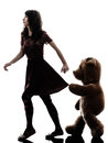 Strange young woman and vicious teddy bear silhouette one caucasian in white background Stock Photography