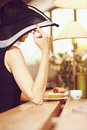 Stranger in a cafe girl wide brimmed hat back Royalty Free Stock Images