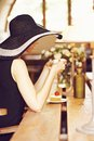 Stranger in a cafe girl wide brimmed hat back Stock Images