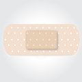 Strapping band aid skin color on a white background Royalty Free Stock Image