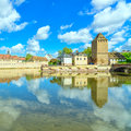 Strasbourg tower of medieval bridge ponts couverts alsace france and reflection barrage vauban Stock Photos