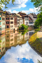 Strasbourg water canal in petite france area unesco site alsace half timbered houses and trees grand ile Stock Photography