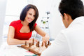 Strategic play businesswoman playing chess in office Stock Photography