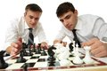 Strategic thinking isolated image of serious businessmen developing their by playing chess Royalty Free Stock Photography