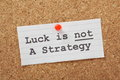 Strategy concept the phrase luck is not a on a cork notice board as a reminder that your business or life plans cannot succeed on Royalty Free Stock Photos