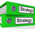 Strategy Folders Show Strategic Planning And Business Processes Stock Photo