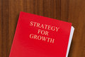 Strategy for growth red folder on desk with title shot from above Stock Photo