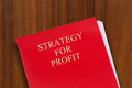 Strategy for profit red folder on desk with title shot from above Royalty Free Stock Image